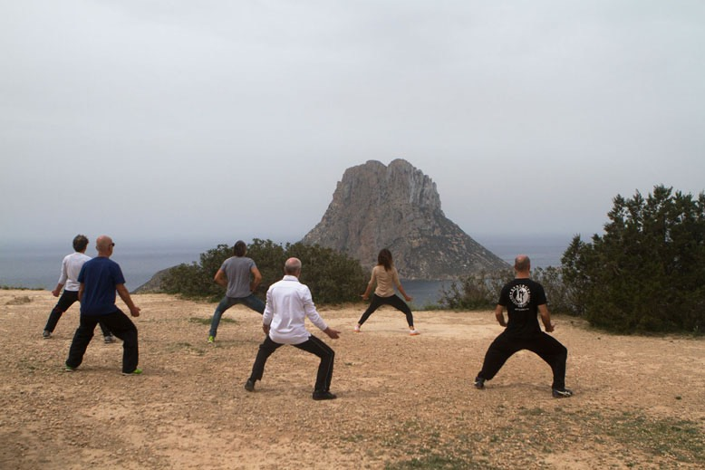 TheFeel ZenmaX Baduanjin qigong exercise, lifting the heavy mountain at Es Vedra Ibiza SpaIN