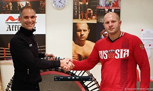 JuatBounce Founder Remy Draaijer, presents a bellicon trampoline to Russian MMA legend Fedor Emelianenko.